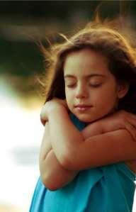 child hugging herself