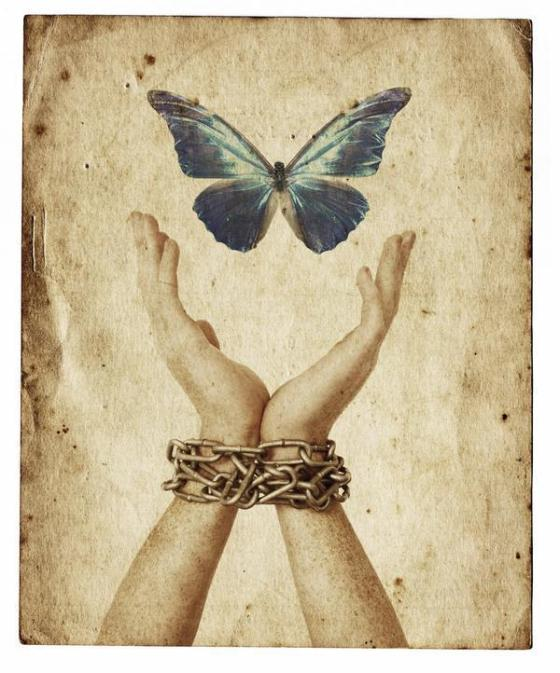 shackled hands releasing a butterfly