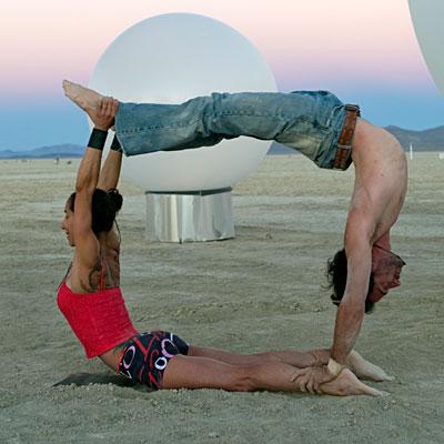 man and woman doing acroyoga