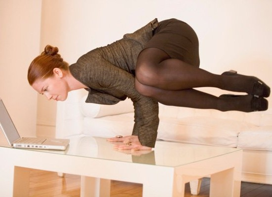 woman doing yoga on desk